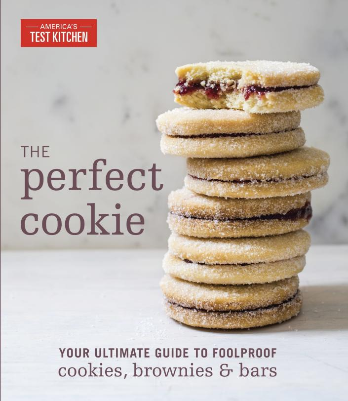 """This image provided by America's Test Kitchen in March 2019 shows the cover for the cookbook """"The Perfect Cookie."""" It includes a recipe for Crunchy Granola Bars. (America's Test Kitchen via AP)"""