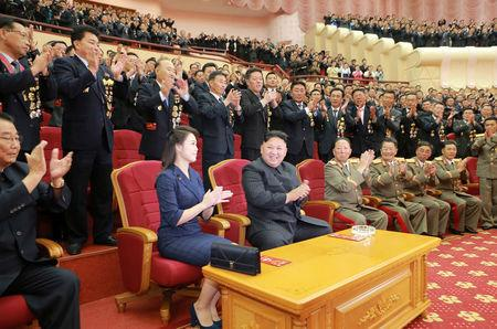 North Korean leader Kim Jong Un claps during a celebration for nuclear scientists and engineers who contributed to a hydrogen bomb test, September 2017.    KCNA via REUTERS