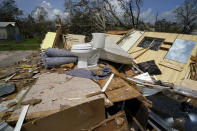Remnants of the half destroyed mobile home of James Towfley, who is living in the standing half, are seen in Lake Charles, La., in the aftermath of Hurricane Laura, Sunday, Aug. 30, 2020. (AP Photo/Gerald Herbert)