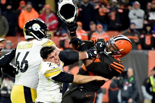 Myles Garrett hits Mason Rudolph with the Pittsburgh quarterback's helmet during a brawl last week (AFP Photo/Jason Miller)