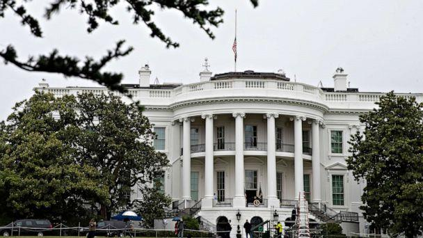 PHOTO: The flag on the roof of the White House flies at half-staff by order of President Donald Trump, 'for every life lost to the coronavirus pandemic,' May 22, 2020, in Washington. (Alex Brandon/AP)