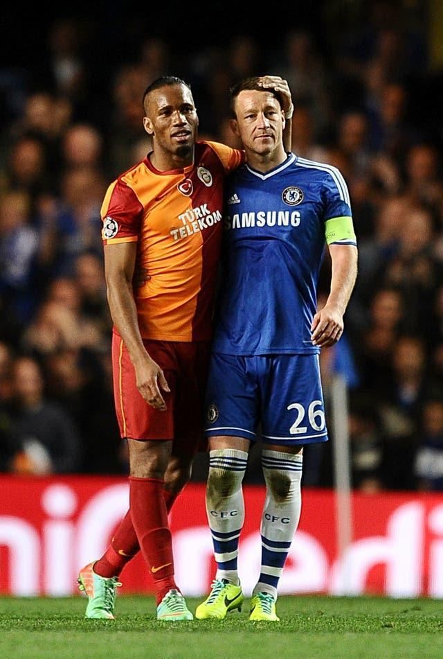 Galatasaray's Didier Drogba (left) and Chelsea's John Terry after playing against each other in the Champions League