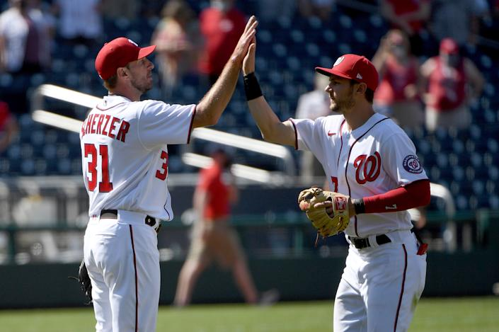 WASHINGTON, DC - MAY 02: Max Scherzer #31 of the Washington Nationals celebrates with Trea Turner #7 after throwing a complete game against the Miami Marlins at Nationals Park on May 02, 2021 in Washington, DC. (Photo by Will Newton/Getty Images)