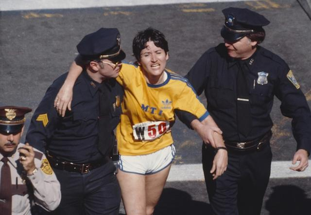 "Rosie Ruiz is shown moments after crossing the finish line as the apparent women's race winner of the 84th Boston Marathon on April 21, 1980. Ruiz was later stripped of her race title after it was determined she had not run the entire race. <span class=""copyright"">(David Madison / Getty Images)</span>"