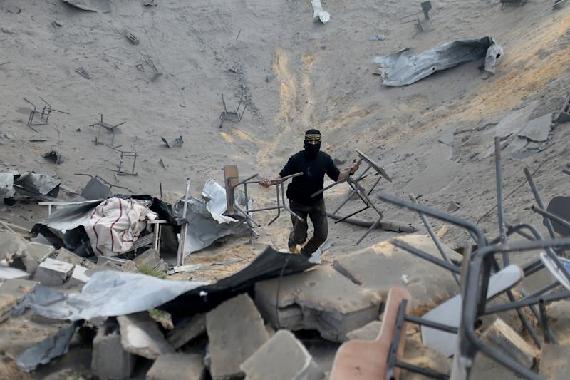 Image: A Palestinian surveys an Islamic Jihad site in Gaza that was targeted in an Israeli air strike.