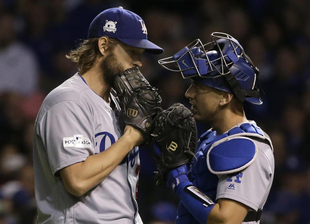 "<a class=""link rapid-noclick-resp"" href=""/mlb/players/8180/"" data-ylk=""slk:Clayton Kershaw"">Clayton Kershaw</a> (L) shares a moment with catcher <a class=""link rapid-noclick-resp"" href=""/mlb/players/9971/"" data-ylk=""slk:Austin Barnes"">Austin Barnes</a> in October. (AP)"