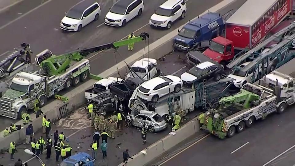 Cars and trucks are wedged together after a deadly multi-vehicle pileup on the ice covered I-35 in a still image from video in Fort Worth, Texas, U.S.