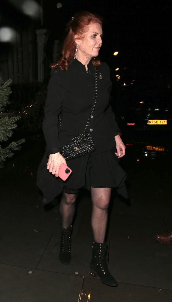 Sarah, Duchess of York seen attending Princess Beatrice's engagement party at Chiltern Firehouse on 18 December 2019 in London wearing black dress and Chanel bag
