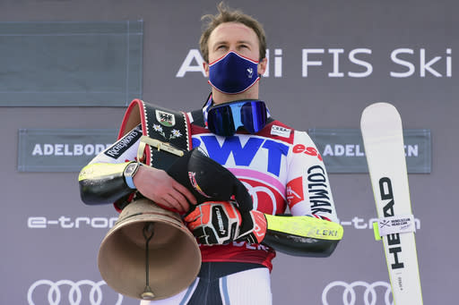 France's Alexis Pinturault stands on the podium after winning an alpine ski, men's World Cup Giant slalom, in Adelboden, Switzerland, Saturday, Jan. 9, 2021. (AP Photo/Marco Tacca)