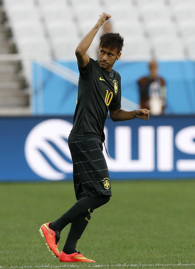 Brazil's Neymar gestures during an official training session the day before the group A World Cup soccer match between Brazil and Croatia in the Itaquerao Stadium in Sao Paulo, Brazil, Wednesday, June 11, 2014. (AP Photo/Kirsty Wigglesworth)