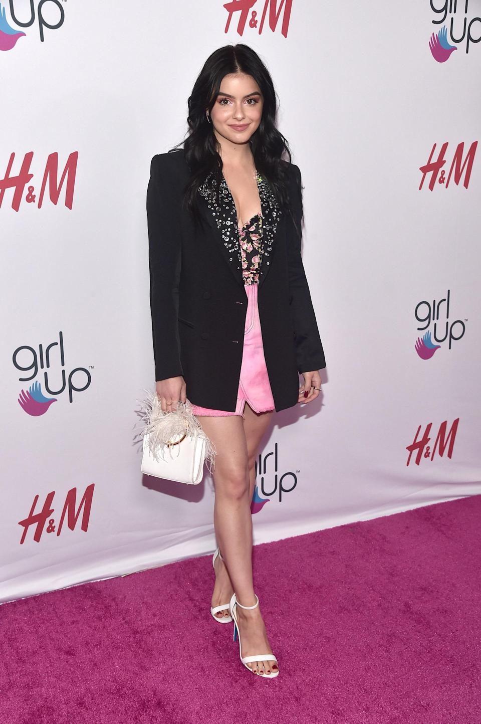 We seriously can't get enough of Ariel's pink slip-like dress, embellished blazer, and feathery white bag.