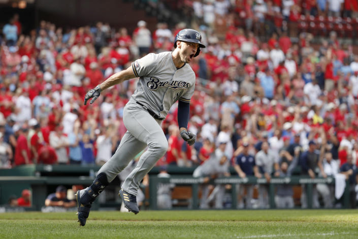 FILE - In this Sept. 15, 2019, file photo, Milwaukee Brewers' Ryan Braun celebrates after hitting a grand slam during the ninth inning of a baseball game against the St. Louis Cardinals in St. Louis. Braun, the Brewers' home run leader whose production was slowed by injuries during the second half of his 14-year career, announced his retirement on Tuesday, Sept. 14, 2021. Braun hasn't played all season and said during spring training that he was leaning toward retirement. (AP Photo/Jeff Roberson, File)