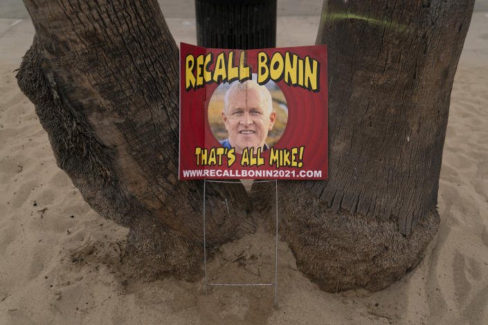 A sign opposing Los Angeles Councilman Mike Bonin, whose district includes Venice, is placed near a homeless encampment set up along the boardwalk in the Venice neighborhood of Los Angeles, Tuesday, June 29, 2021. The proliferation of homeless encampments on Venice Beach has sparked an outcry from residents and created a political spat among Los Angeles leaders. Residents fumed at City Councilman Mike Bonin, saying he neglected the area for too long. (AP Photo/Jae C. Hong)