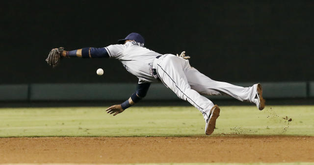 Tampa Bay Rays shortstop Yunel Escobar is unable to catch a hit by Texas Rangers' Elvis Andrus during the sixth inning of a baseball game, Wednesday, Aug. 13, 2014, in Arlington, Texas. (AP Photo/Brandon Wade)