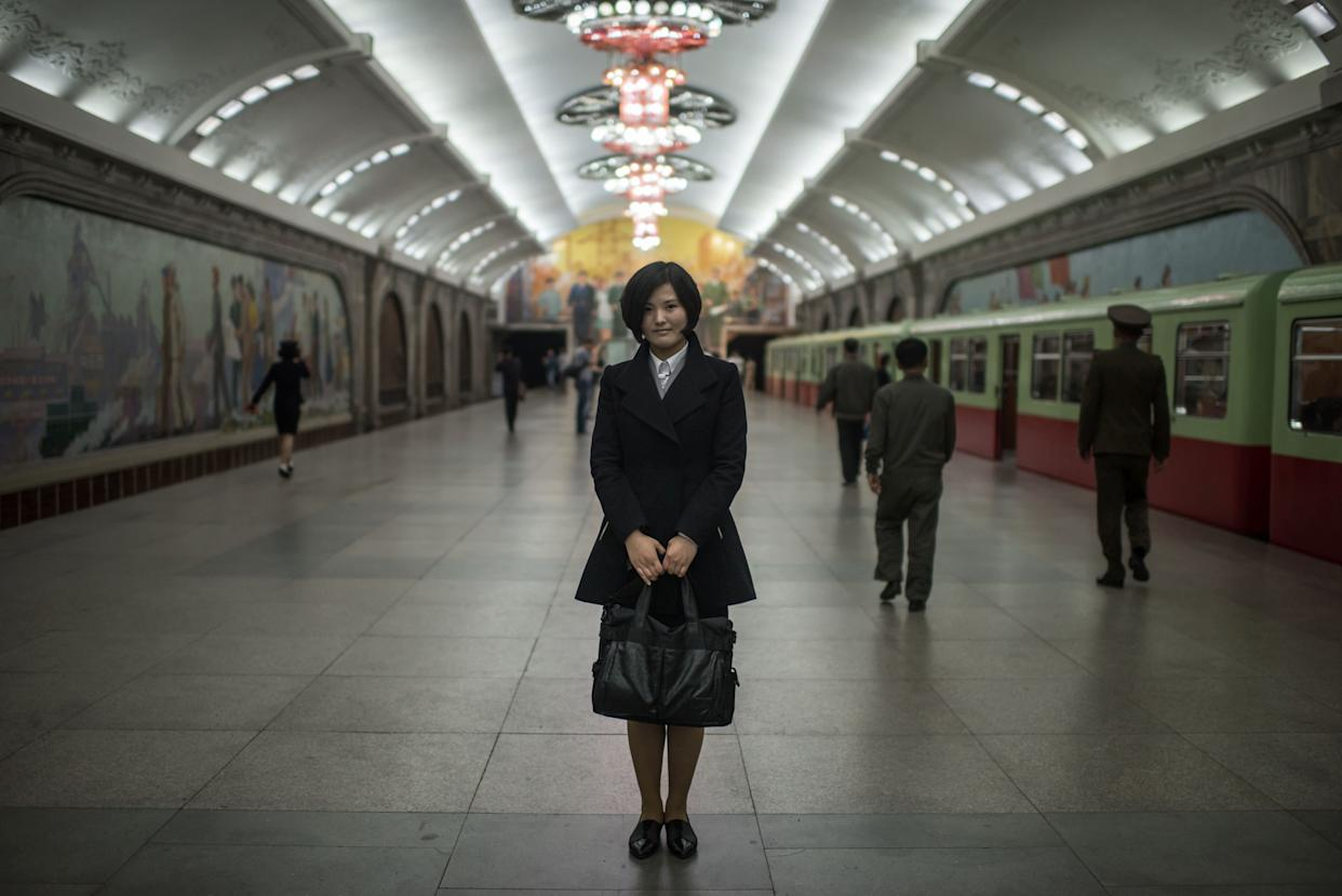 Student Cha So-Yon, 18, poses for a portrait in a subway station of the Pyongyang metro.
