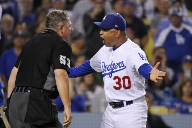 Los Angeles Dodgers manager Dave Roberts, right, argues with home plate umpire Greg Gibson after being ejected during the fourth inning of the team's baseball game against the Colorado Rockies on Friday, Sept. 20, 2019, in Los Angeles. (AP Photo/Mark J. Terrill)