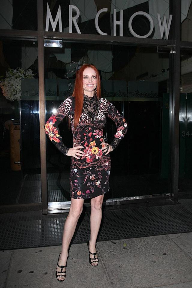 "The grotesque getups worn by our favorite F-lister Phoebe Price never cease to amaze and sicken us. Her latest bomb, a lacy floral frock, exploded in front of Mr. Chow, an elite Beverly Hills eatery that should enforce a dress code to prevent fashion faux pas of this magnitude. Larry Chen/<a href=""http://www.splashnewsonline.com"" target=""new"">Splash News</a> - May 28, 2008"