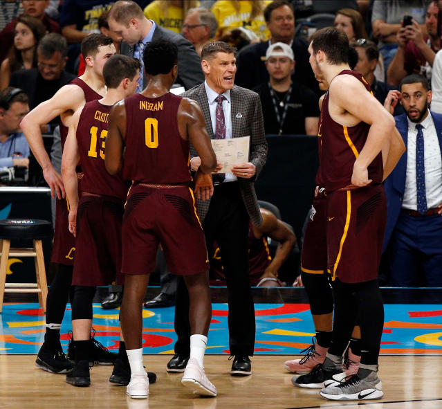 Loyola-Chicago head coach Porter Moser talks to his players during a timeout in the first half in the semifinals of the Final Four NCAA college basketball tournament against Michigan , Saturday, March 31, 2018, in San Antonio. (AP Photo/Brynn Anderson)