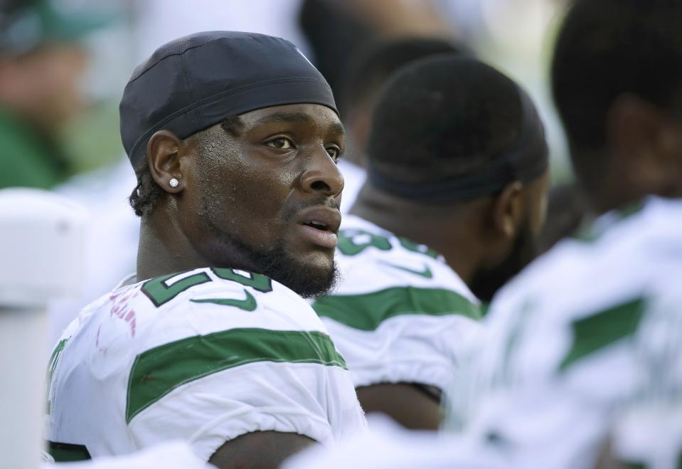 New York Jets running back Le'Veon Bell watches from the sideline near the end of the second half of an NFL football game against the New England Patriots, Sunday, Sept. 22, 2019, in Foxborough, Mass. (AP Photo/Steven Senne)