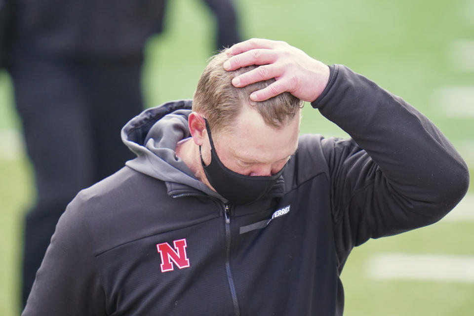 Nebraska head coach Scott Frost walk off the field following an NCAA college football game against Minnesota in Lincoln, Neb., Saturday, Dec. 12, 2020. Minnesota won 24-17. (AP Photo/Nati Harnik)