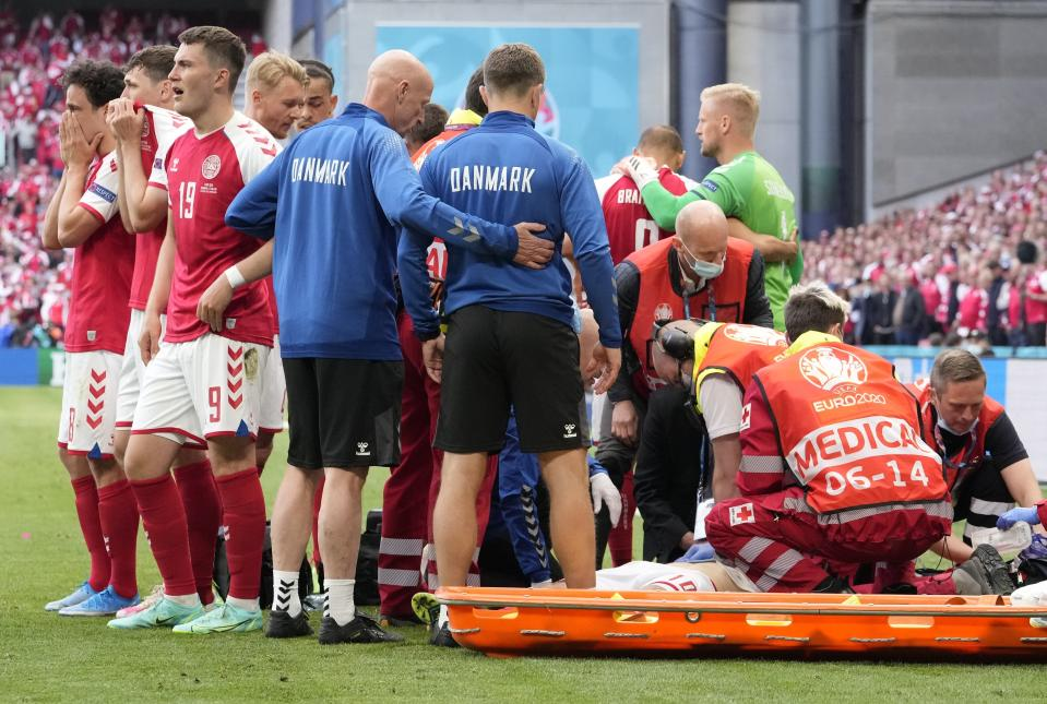 Denmark's Christian Eriksen receives medical treatment after collapsing during the Euro 2020 soccer championship group B match between Denmark and Finland at Parken stadium in Copenhagen, Saturday, June 12, 2021. (AP Photo/Martin Meissner, Pool)
