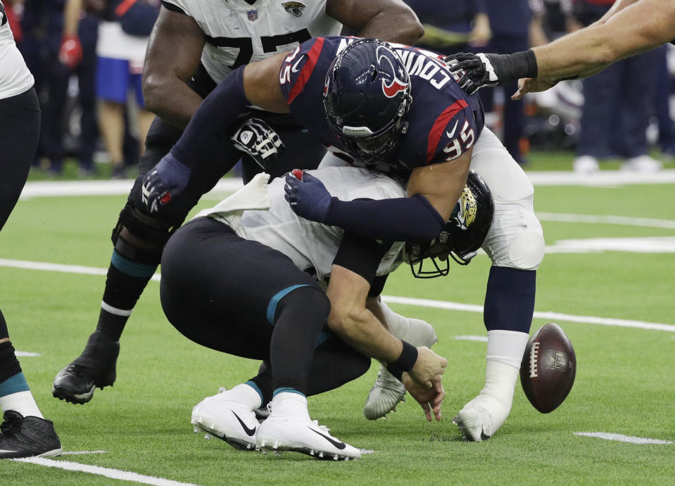 Houston Texans defensive end Christian Covington (95) hits Jacksonville Jaguars quarterback Blake Bortles (5) causing a fumble during the first half of an NFL football game, Sunday, Dec. 30, 2018, in Houston. Jacksonville recovered the ball. (AP Photo/David J. Phillip)