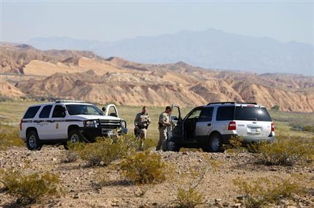 Federal law enforcement personnel block access to thousands of acres of BLM land that have been temporarily closed to round up illegal cattle that are grazing, south of Mesquite, Nevada
