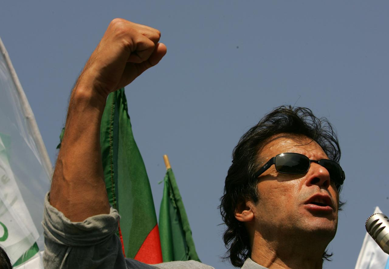 ISLAMABAD, PAKISTAN - October 17 : Former Pakistani cricket star-turned politician Imran Khan (3rd from left), speaks at an anti government rally in front of the Supreme Court October 17, 2007 in Islamabad, Pakistan. The Surpeme Court is going to make a ruling soon as they challenge the legality of General Pervez Musharraf's re-election as President. This court hearing takes place a day before the former Prime Minister Benazir Bhutto returns from exile.   (Photo Paula Bronstein/Getty Images)