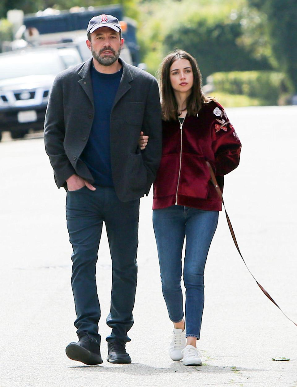 """<p>The pair <a href=""""https://people.com/movies/ben-affleck-and-ana-de-armas-split-source/"""" rel=""""nofollow noopener"""" target=""""_blank"""" data-ylk=""""slk:called it quits"""" class=""""link rapid-noclick-resp"""">called it quits</a> after nearly a year together, PEOPLE announced on Jan. 18. </p> <p>""""Ben is no longer dating Ana,"""" a source told PEOPLE. """"She broke it off. Their relationship was complicated. Ana doesn't want to be Los Angeles based and Ben obviously has to since his kids live in Los Angeles.""""</p> <p>Affleck, 48, and the <i>Knives Out</i> actress, 32, were <a href=""""https://people.com/movies/ben-affleck-ana-de-armas-split-look-back-at-their-relationship/"""" rel=""""nofollow noopener"""" target=""""_blank"""" data-ylk=""""slk:first romantically linked"""" class=""""link rapid-noclick-resp"""">first romantically linked</a> in early March 2020, when they were seen on a trip to her native Cuba after meeting while filming the upcoming thriller <i>Deep Water</i> in New Orleans.</p> <p>The pair were frequently spotted together on daily walks in L.A. throughout the summer. </p>"""