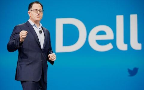 Michael Dell, founder and chief executive officer of Dell speaks at a conference - Credit: Getty images