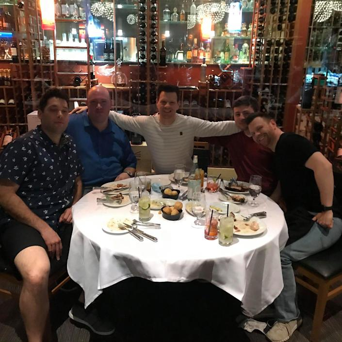 Graves and Freedy have dinner with friends at a restaurant.