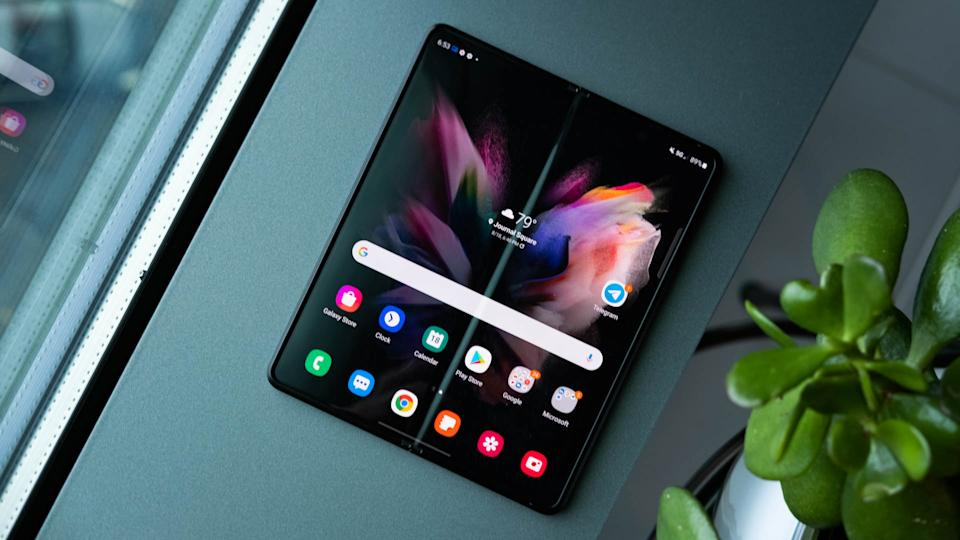 The Samsung Galaxy Z Fold 3 laying open, flat on its back, on a window ledge.