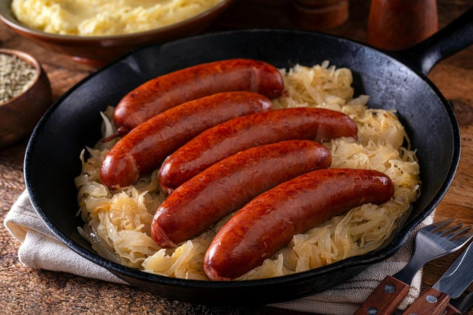 """<div><p>""""To me, Ohio food means kielbasa and sauerkraut and pierogies."""" </p><p>—<a href=""""https://www.reddit.com/user/StacyChadBecky/"""" rel=""""nofollow noopener"""" target=""""_blank"""" data-ylk=""""slk:u/StacyChadBecky"""" class=""""link rapid-noclick-resp"""">u/StacyChadBecky</a><b>Runner-up</b>: """"Ohio has to be some Cincinnati-style chili. Placed atop a hot dog or spaghetti and topped with cheese!"""" —<a href=""""https://www.reddit.com/user/NotABadBelayer/"""" rel=""""nofollow noopener"""" target=""""_blank"""" data-ylk=""""slk:u/NotABadBelayer"""" class=""""link rapid-noclick-resp"""">u/NotABadBelayer</a></p></div><span> Getty Images</span>"""