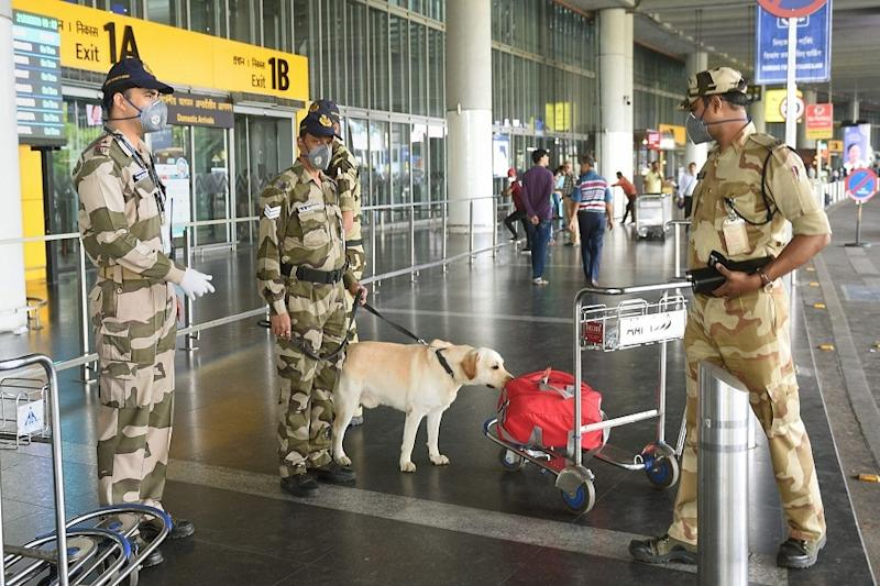 CISF jawans check unattended baggage at Kolkata airport. (PTI)