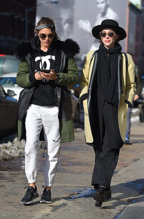 Despite the freezing temps in NYC this winter, Delevingne and Clark managed to look totally put-together on a stroll out in SoHo. Delevingne went for a sporty style, donning a bandana, Chanel hoodie, jogging pants, and sneakers, and Clark chose sophisticated, oversized pieces with a porkpie hat.