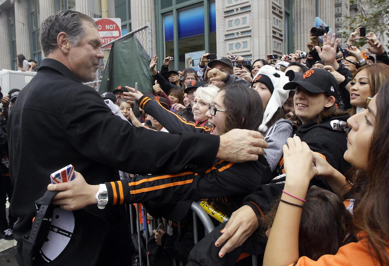 San Francisco Giants manager Bruce Bochy hugs fan Jackie Day, 14, before the San Francisco Giants World Series victory parade, Wednesday, Oct. 31, 2012, in San Francisco. (AP Photo/Jeff Chiu)