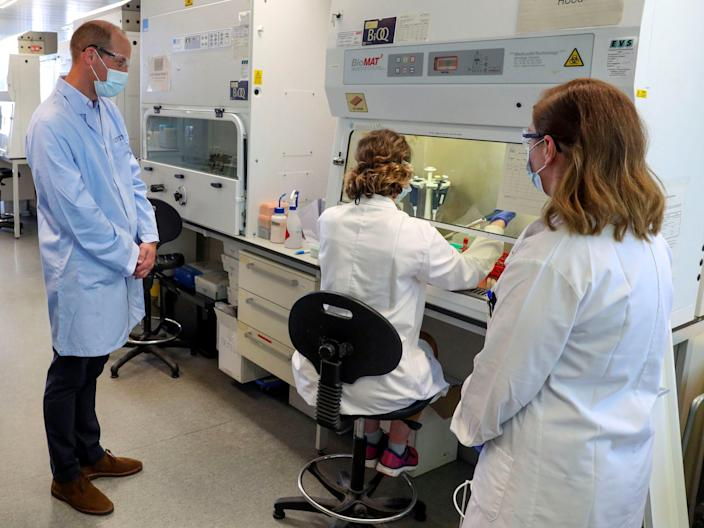 Britain's William, Duke of Cambridge, wears a mask as he meets scientists during a visit to the manufacturing laboratory where a vaccine against the coronavirus disease (COVID-19) has been produced at the Oxford Vaccine Group's facility at the Churchill Hospital in Oxford, Britain, June 24, 2020. Steve Parsons/Pool via REUTERS