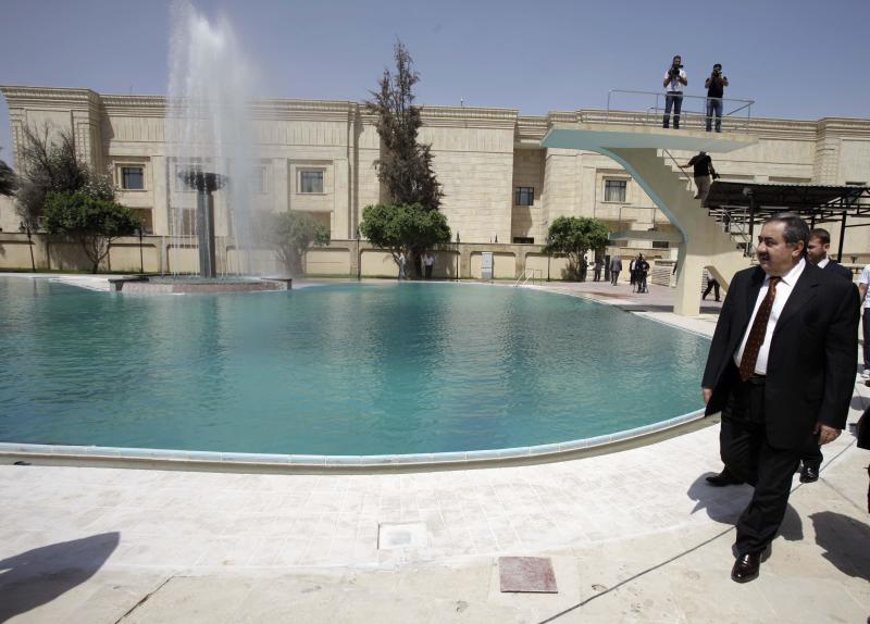 FILE - In this Monday, April 11, 2011 file photo, Iraqi Foreign Affairs Minister Hoshyar Zebari walks on the grounds of the conference palace dedicated to the coming Arab League summit in Baghdad, Iraq. A summit of Arab leaders, held here for the first time in a generation, is a prime opportunity for Iraq to reassert itself as a political player in the Arab world after years of war, isolation and American occupation. It also puts Iraq's Shiite leadership under pressure to pick a side in the bitter sectarian politics dividing the region. Iraq's suspicious Arab brethren will likely use the crisis in Syria as a litmus test whether Baghdad is with them or with their top rival, Shiite-led Iran. (AP Photo/Karim Kadim, File)