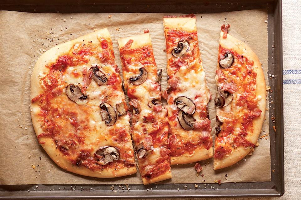 "Crisp pancetta and thinly sliced mushrooms give this three-cheese pizza with a wafer-thin crust an umami boost. <a href=""https://www.epicurious.com/recipes/food/views/three-cheese-pizza-with-pancetta-and-mushrooms-237339?mbid=synd_yahoo_rss"" rel=""nofollow noopener"" target=""_blank"" data-ylk=""slk:See recipe."" class=""link rapid-noclick-resp"">See recipe.</a>"