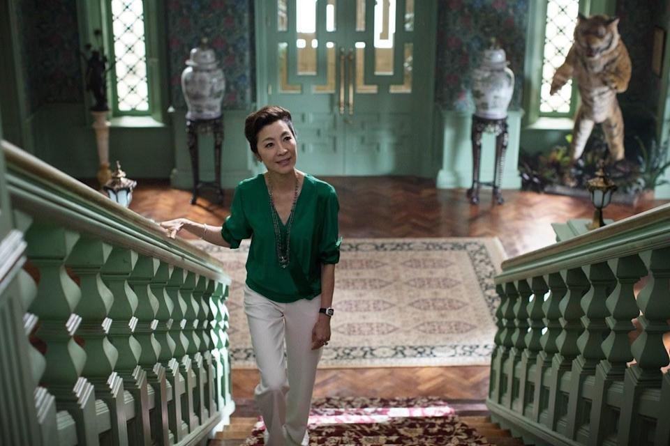 """Eleanor Young (Michelle Yeoh) in the Young family's ancestral home in the film """"Crazy Rich Asians"""". (Photo: Warner Bros.)"""