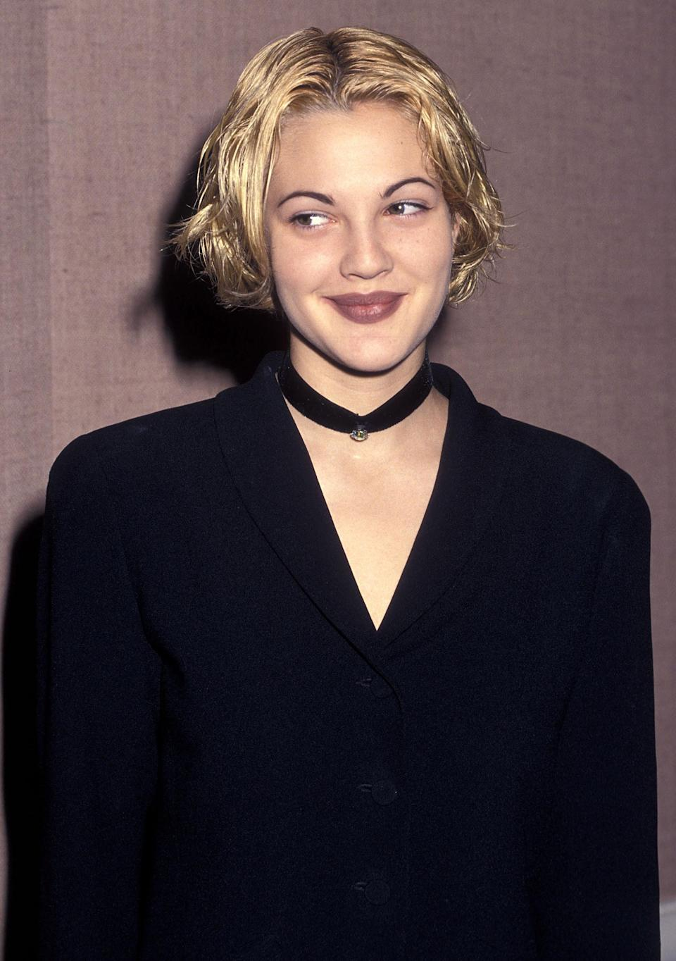 Photo of Drew Barrymore in a mauve lip and cropped hair