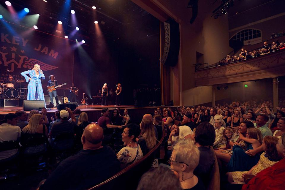 """<p>Lauren Alaina made Whiskey Jam founder Ward Guenther's daughter, coincidentally named Ryman, first Whiskey Jam experience truly unforgettable. As she closed out her inspirational anthem """"Road Less Traveled,"""" Alaina called Ryman up to the stage to sing along as hundreds of cellphone flashlights swayed in time. </p>"""