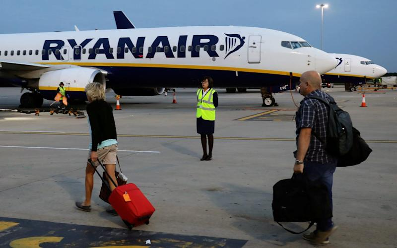 Turbulence: Passengers boarding a Ryanair flight at Stansted Airport, - REUTERS