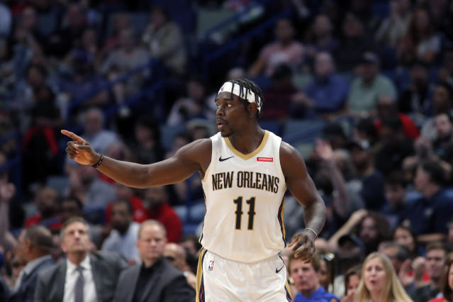 New Orleans Pelicans guard Jrue Holiday (11) reacts after making a 3-point basket in the first half of an NBA basketball game against the Orlando Magic in New Orleans, Sunday, Dec. 15, 2019. (AP Photo/Gerald Herbert)