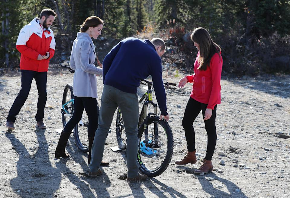 CARCROSS, BC - SEPTEMBER 28:  Catherine, Duchess of Cambridge and Prince William, Duke of Cambridge talk to locals about mountain bikes on Montana mountain near Carcross during the Royal Tour of Canada on September 28, 2016 in Carcross, Canada. Prince William, Duke of Cambridge, Catherine, Duchess of Cambridge, Prince George and Princess Charlotte are visiting Canada as part of an eight day visit to the country taking in areas such as Bella Bella, Whitehorse and Kelowna  (Photo by Andrew Milligan - Pool/Getty Images)