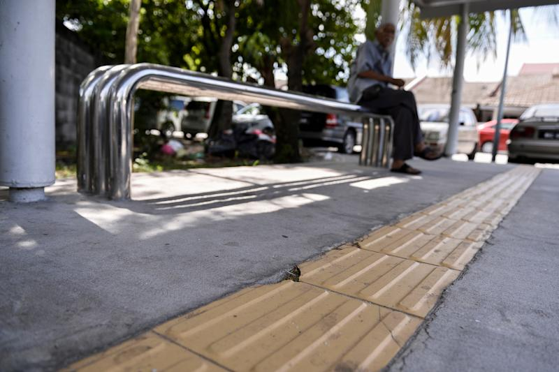 Lack of maintenance of markings on a pedestrian walkway for the disabled. — Picture by Miera Zulyana