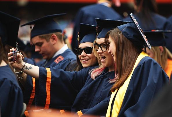 Syracuse University graduates take a picture together during the 2012 Syracuse University Commencement at Syracuse University on May 13, 2012 at the Carrier Dome in Syracuse, New York. (Photo by Nate Shron/Getty Images)