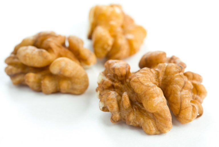 """<p>Walnuts give you a healthy dose of <a href=""""https://www.healthline.com/nutrition/benefits-of-walnuts#section2"""" rel=""""nofollow noopener"""" target=""""_blank"""" data-ylk=""""slk:alpha-linolenic acid"""" class=""""link rapid-noclick-resp"""">alpha-linolenic acid</a>, an omega-3 fat that's been shown to improve <a href=""""https://www.womansday.com/health-fitness/wellness/g19809674/alzheimers-disease-support/"""" rel=""""nofollow noopener"""" target=""""_blank"""" data-ylk=""""slk:memory and coordination"""" class=""""link rapid-noclick-resp"""">memory and coordination</a>.</p><p><strong>Recipe to try:</strong> <a href=""""https://www.womansday.com/food-recipes/food-drinks/a22476568/peach-blue-cheese-and-walnut-salad-recipe/"""" rel=""""nofollow noopener"""" target=""""_blank"""" data-ylk=""""slk:Peach, Blue Cheese, and Walnut Salad"""" class=""""link rapid-noclick-resp"""">Peach, Blue Cheese, and Walnut Salad</a></p>"""