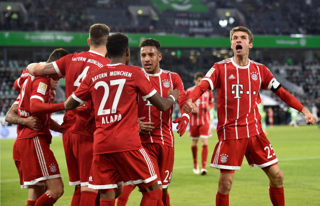 Soccer Football - Bundesliga - VfL Wolfsburg vs Bayern Munich - Volkswagen Arena, Wolfsburg, Germany - February 17, 2018 Bayern Munich's Robert Lewandowski celebrates scoring their second goal with David Alaba, Thomas Muller and team mates REUTERS/Fabian Bimmer DFL RULES TO LIMIT THE ONLINE USAGE DURING MATCH TIME TO 15 PICTURES PER GAME. IMAGE SEQUENCES TO SIMULATE VIDEO IS NOT ALLOWED AT ANY TIME. FOR FURTHER QUERIES PLEASE CONTACT DFL DIRECTLY AT + 49 69 650050