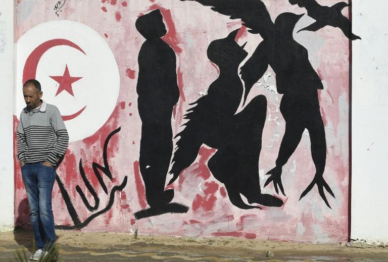 Graffiti depicts a man metamorphosing into a bird symbolising freedom, in Mohamed Bouazizi Square -- named after the street vendor who sparked the revolution -- in the town of Sidi Bouzid